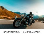 motorcycle driver riding... | Shutterstock . vector #1054622984