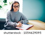 pensive hipster girl in optical ... | Shutterstock . vector #1054629095