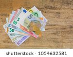 Small photo of Different Euro banknote money and coins. Set of 500 200 100 50 20 10 5 European currency on weathered wooden background