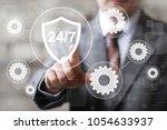 businessman presses button 24... | Shutterstock . vector #1054633937