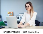 female creative worker working... | Shutterstock . vector #1054639517