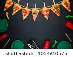 Small photo of Slices of pizza in the form of a garland with the attributes of a party. Pizza slices on a gray concrete background. Space for text. Pizza menu. Birthday with fast food.