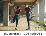 young couple warming up in... | Shutterstock . vector #1054655051