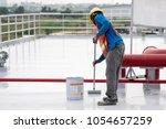construction worker coating...   Shutterstock . vector #1054657259