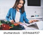 beautiful smiling girl using... | Shutterstock . vector #1054666937
