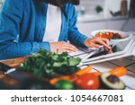 closeup of female cook using... | Shutterstock . vector #1054667081