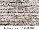 cracked black brick wall ... | Shutterstock . vector #1054682891