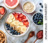 acai smoothie bowl with banana  ... | Shutterstock . vector #1054685807