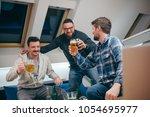 group of friends watching sport ... | Shutterstock . vector #1054695977