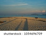 the atmosphere around koh lipe... | Shutterstock . vector #1054696709