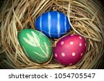painted easter eggs in the... | Shutterstock . vector #1054705547