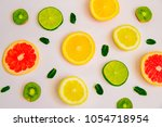 fruit summer pattern on a white ... | Shutterstock . vector #1054718954