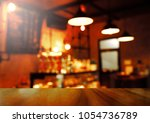 top of wood table with blur... | Shutterstock . vector #1054736789