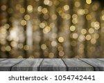wood table gold bokeh background | Shutterstock . vector #1054742441