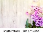 lilac flowers on wooden table... | Shutterstock . vector #1054742855