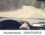 driving a car view on the road  | Shutterstock . vector #1054742915
