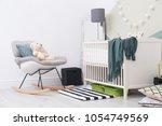 beautiful interior of baby room ... | Shutterstock . vector #1054749569