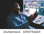 businessman surprised with...   Shutterstock . vector #1054752665