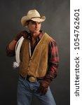 the sexy cowboy man awaits his... | Shutterstock . vector #1054762601