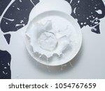 paint or milk splashing in the...   Shutterstock . vector #1054767659