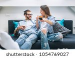 young couple sitting on the... | Shutterstock . vector #1054769027