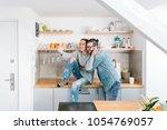 young couple taking selfie in... | Shutterstock . vector #1054769057