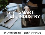 smart industry. industrial and... | Shutterstock . vector #1054794401