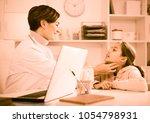 teenage girl visits doctor in... | Shutterstock . vector #1054798931