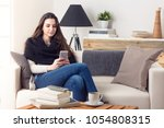 portrait of smiling woman using ... | Shutterstock . vector #1054808315