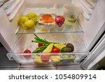 fridge door opening  looking... | Shutterstock . vector #1054809914