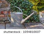 watering can in a garden | Shutterstock . vector #1054810037