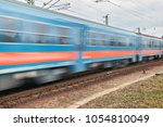 train passing by with motion...   Shutterstock . vector #1054810049