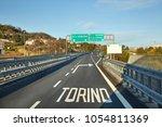 highway with exit sign towards...   Shutterstock . vector #1054811369