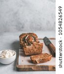 Small photo of Butter-free,sugar-free banana bread with oat flour,soft curd cheese,honey.Side view sliced banana bread on wooden cutting board.Copy space.Ideas recipe healthy diet breakfast. Selective focus.Vertical