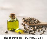 hemp seeds and hemp oil on... | Shutterstock . vector #1054827854