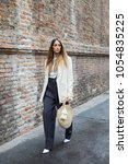 Small photo of MILAN - FEBRUARY 22: Elisa Taviti with white jacket and black trousers before Max Mara fashion show, Milan Fashion Week street style on February 22, 2018 in Milan.