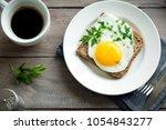 fried egg on wholegrain toast... | Shutterstock . vector #1054843277