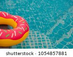 rubber ring in blue swimming... | Shutterstock . vector #1054857881