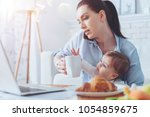 very busy. serious attractive... | Shutterstock . vector #1054859675
