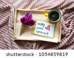 breakfast on a tray in bed with ... | Shutterstock . vector #1054859819