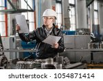 a young successful engineer... | Shutterstock . vector #1054871414