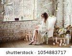 bride's preparations in loft... | Shutterstock . vector #1054883717