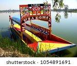 trajinera at lake xochimilco in ... | Shutterstock . vector #1054891691