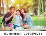 asian teen family happy holiday ... | Shutterstock . vector #1054895255
