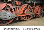 old red train wheels of a old... | Shutterstock . vector #1054915931