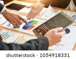 close up business people hands... | Shutterstock . vector #1054918331