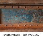 green and red rusted metal with ... | Shutterstock . vector #1054922657