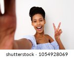portrait of smiling young... | Shutterstock . vector #1054928069