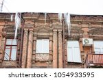 building covered with big... | Shutterstock . vector #1054933595