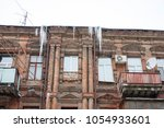 building covered with big... | Shutterstock . vector #1054933601